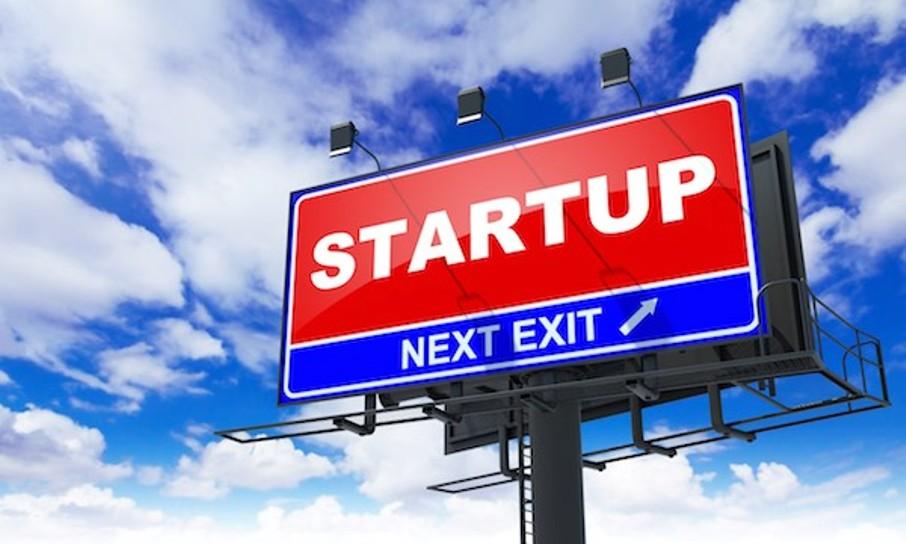 Startup - Red Billboard on Sky Background. Business Concept.